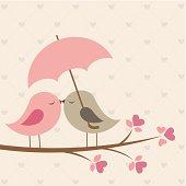 Love birds under umbrella