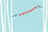 A birds-eye view of love. Two birds hold up a string of red hearts. Snow is on a separate layer as are all other elements. Copy space for your message of love.