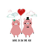 A couple of funny pigs holding hands and heart balloon. Love greeting card with phrase: love is in the air.