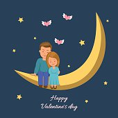 Love couple sitting on the moon.
