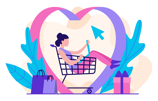 Love for online shopping concept. A girl sits in a shopping cart and looks at her laptop, making purchases.