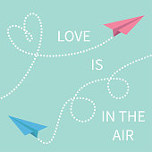 Love is in the air Lettering text. Two flying origami paper plane Dashed line Heart loop Happy Valentines day Greeting card Typographical blue sky background with quote Flat design Vector illustration