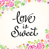 Love is sweet calligraphy in a spring bloom background.