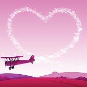 Biplane skywriting a heart shape.