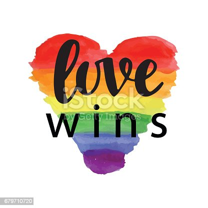 Love wins. Pride slogan. Gay rights concept. Vector hand lettering on bright watercolor rainbow heart, homosexuality emblem. Banner, poster, placard, invitation card typographic design