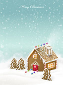 lovely Christmas gingerbread house isolated on snowy background