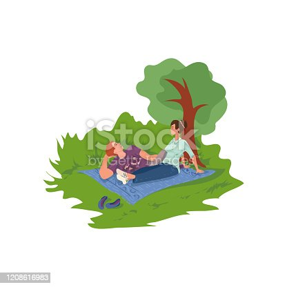 istock Lovely cute couple is rest in city park and talking 1208616983