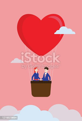 istock Lover float in the sky by a heart shape balloon 1219529894