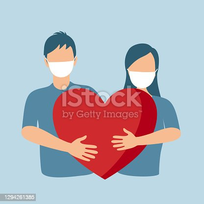 istock Loving couple in protective mask hugging red heart. Love in covid19 Coronavirus quarantine pandemic times. Design for Valentine's Day greeting card, poster, banner. 1294261385