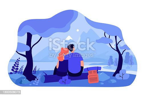 istock Loving couple sitting on nature together 1300508073
