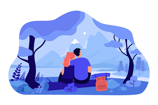 Loving couple sitting on nature together