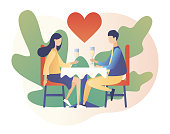 istock Loving couple spending time or relaxing together. Romantic dinner in restaurant. Romantic date concept. Characters Valentine day. Modern flat cartoon style. Vector illustration on white background 1195563121