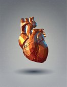 Low poly 3D human heart on gray background