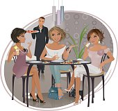 Three Ladies who lunch, having fun chatting together, while the waiter brings a large pizza to share.