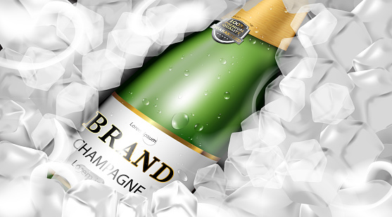 Luxury champagne bottle green color with water drop on ice cubes background
