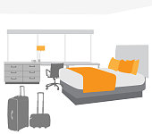 Empty hotel bedroom with luggage