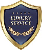 Luxury service quality gold shield with five stars.