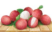Lychee fruits and leaves on wooden surface. Vector illustration
