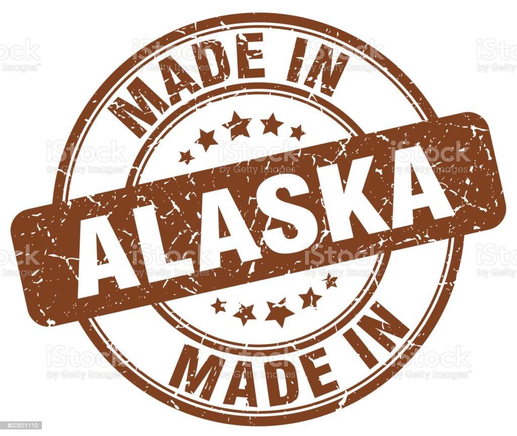 made in Alaska brown grunge round stamp vector art illustration