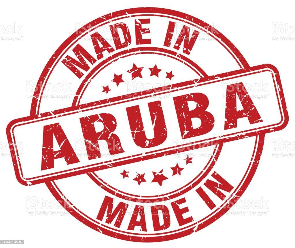 made in Aruba red grunge round stamp vector art illustration
