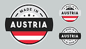 Made in Austria collection of ribbon, label, stickers, badge, icon and page curl with Austria flag symbol.