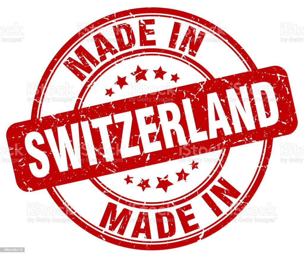 made in Switzerland red grunge round stamp - Grafika wektorowa royalty-free (Białe tło)