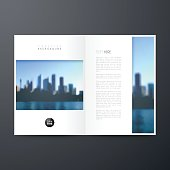 Magazine template with an view of skyscrapers. Blurred city background.