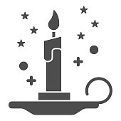Magic candle solid icon, Halloween concept, burning candle and stars sign on white background, wax candle on candlestick icon in glyph style for mobile, web design. Vector graphics