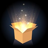 istock Magic cardboard box with light 941339880