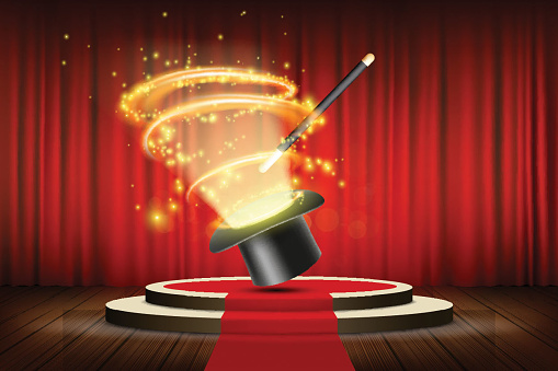 Magic wand and hat on stage with curtain. Focus and entertainment.