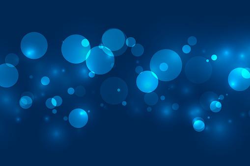 magical blue bokeh shimmer lights background design