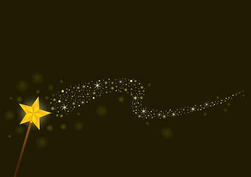 A magical yellow wand giving off light and sparkles
