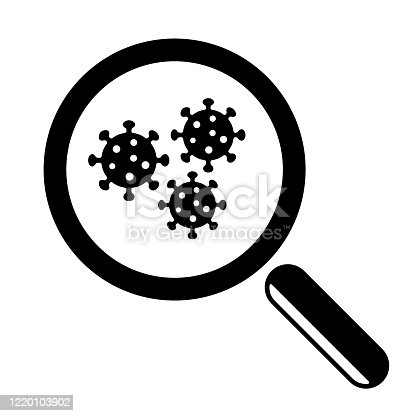 istock Magnifying glass and virus cell close up. 1220103902