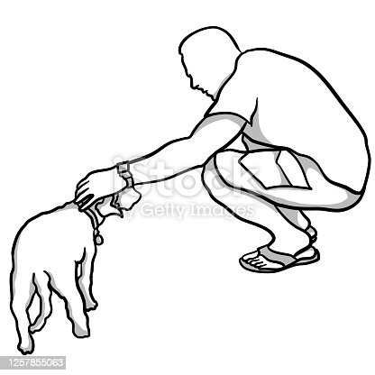 A man crouching to pet a dog