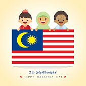 16th september - Happy Malaysia Day illustration. Cute cartoon character kids of Malay, Indian & Chinese holding Malaysia flag.