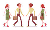 Male and female clerk walking
