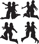 Male and female silhouettes jumping chest bumps