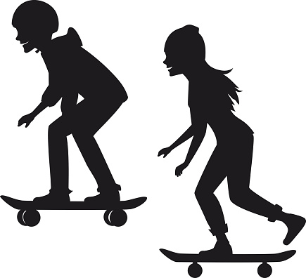 male and female skateboarders silhouettes