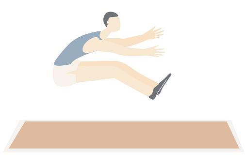 Male athlete jumping at stadium