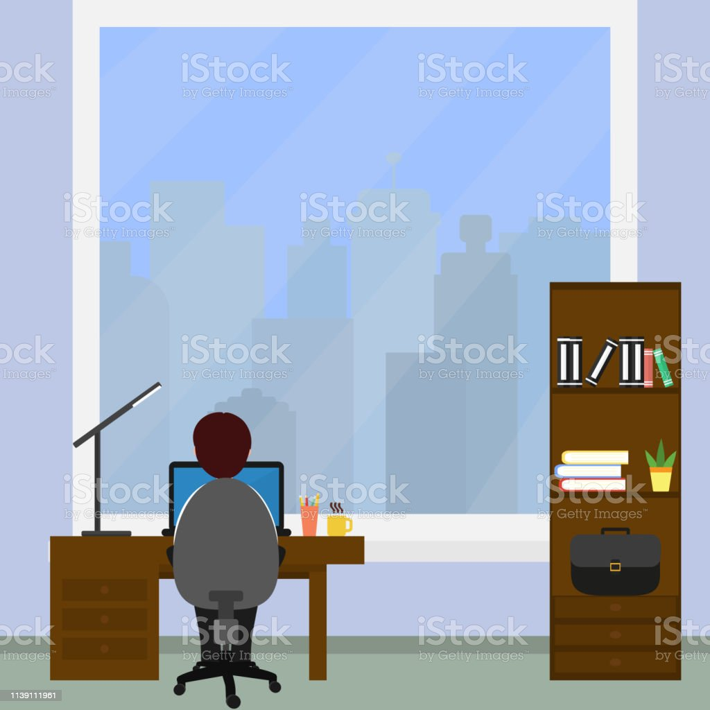 Male Businessman Sitting At Work On The Computer In The