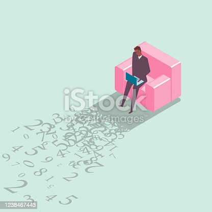 A male businessman working in the sofa.