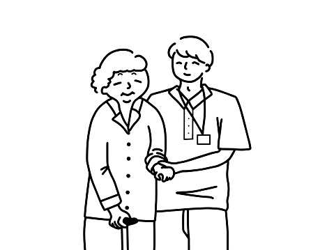 A male caregiver assisting an elderly woman.