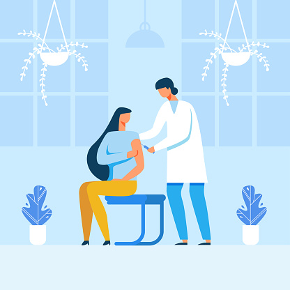 Male Doctor Making Injection to Female Patient