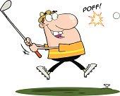 Male Golfer Hitting Golf Ball With Grass