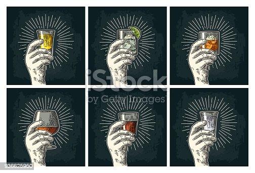 istock Male hand holding glass brandy, tequila, gin, vodka, rum, whiskey. 936625950