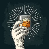 Male hand holding glass whiskey with ray. Vintage color and monochrome vector engraving illustration for label, poster, invitation to party. Isolated on dark background