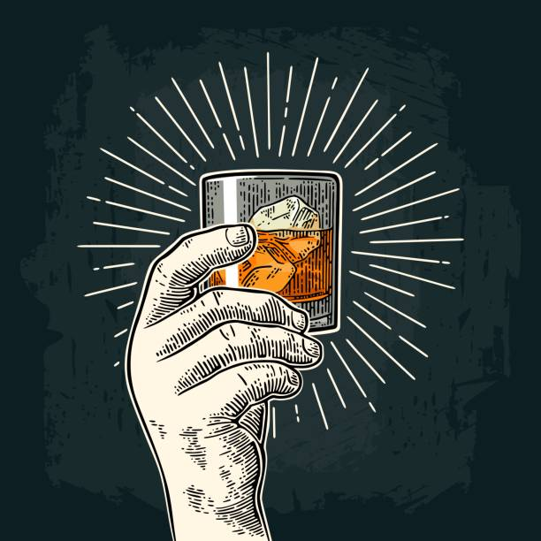 male hand holding glass whiskey with ray. vintage vector engraving - kieliszek stock illustrations