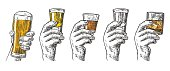 Male hand holding glasses with beer, tequila, vodka, rum, whiskey