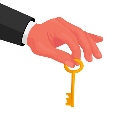 Male Hand in Formal Wear Holding Gold Key in Fingers Isolated on White Background. Real Estate Agent, Rent or Mortgage