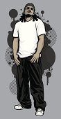 Vector illustration of a young, male, urban hip-hop model posing with his thumbs in his pockets. Model is wearing a white t-shirt, baggy black pants and a dark gray stocking cap, posing in front of graffiti design elements in the background. File is made with minimal global color swatches. Model and design elements are on separate layers.